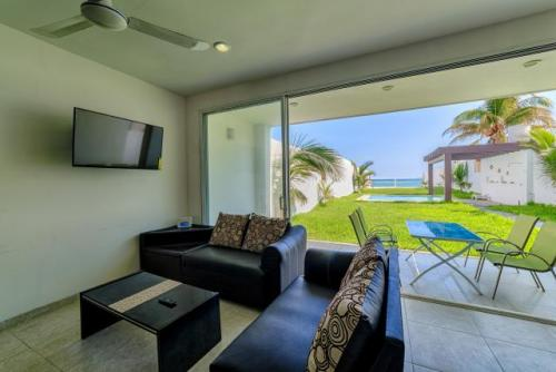 Ground Floor Oceanfront Condominium in Chelem property for sale