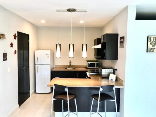 Turn key condo located in Central Playa del Carmen. property for sale