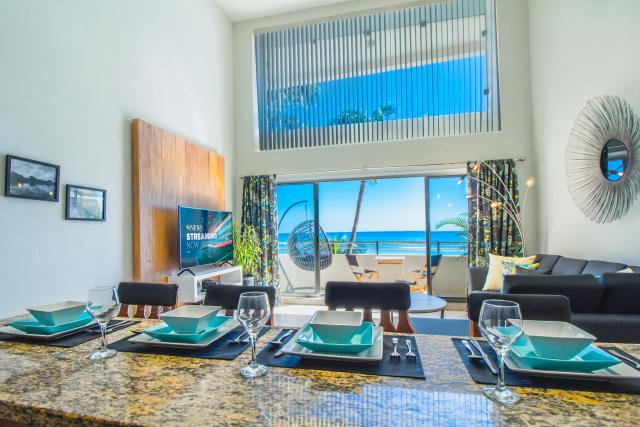 TRUE OCEANFRONT LOFT-STYLE CONDO property for sale